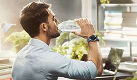 Thumbnail of person drinking from a water bottle wearing Gear Sport