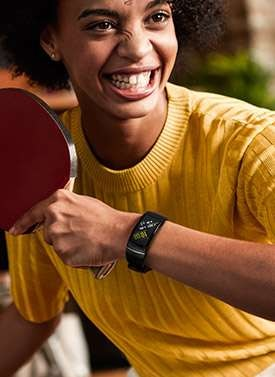 Thumbnail of person playing ping pong wearing Gear Fit2 Pro