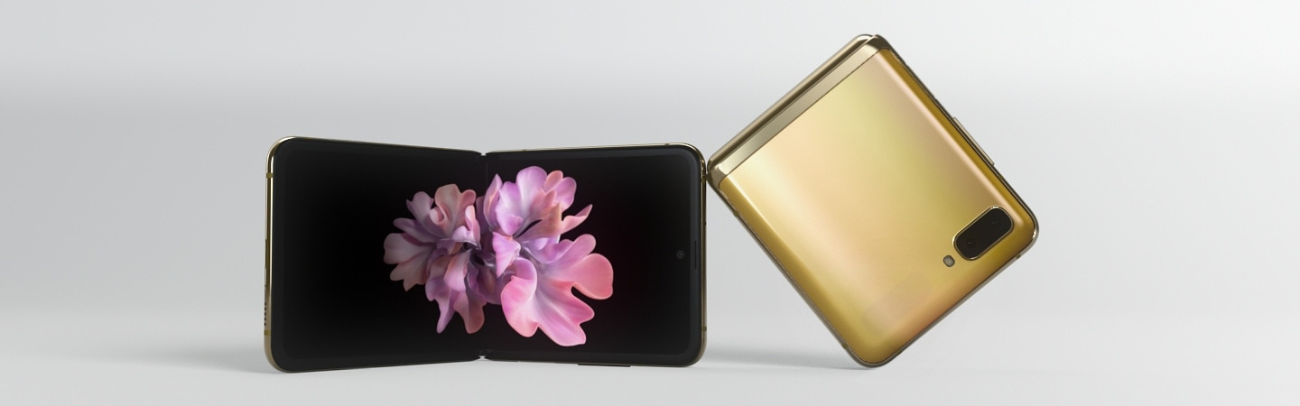 A Samsung Galaxy Z Flip gold mobile is lying 120 degrees folded, and the other completely folded mobile phone is lying on the other.