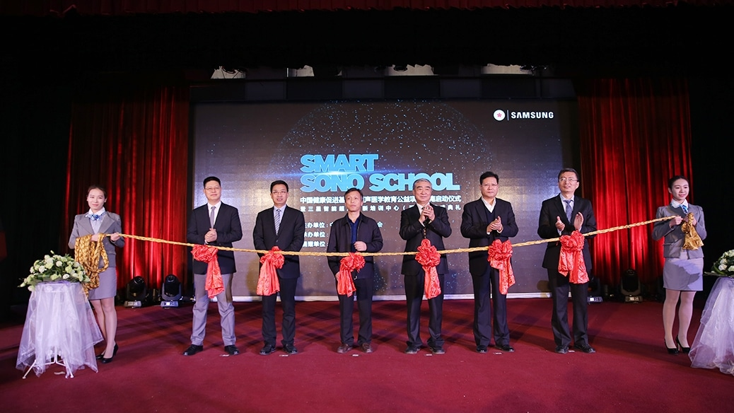 This is a photo of a smart sono school tape cutting group.