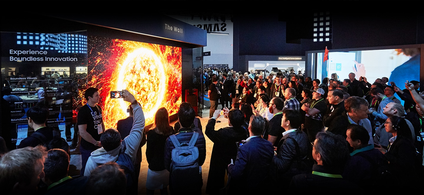 A large crowd of attendees gather around The Wall 2019 on display at the VD zone inside the Samsung booth at CES 2019.