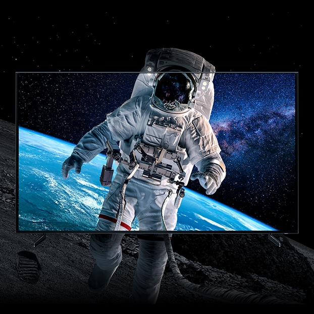 Closeup shot of an astronaut in space, displayed in full color within a QLED 8K screen, as the image bleeds out outside of the screen to demonstrate how realistic the images appear with 8K definition.