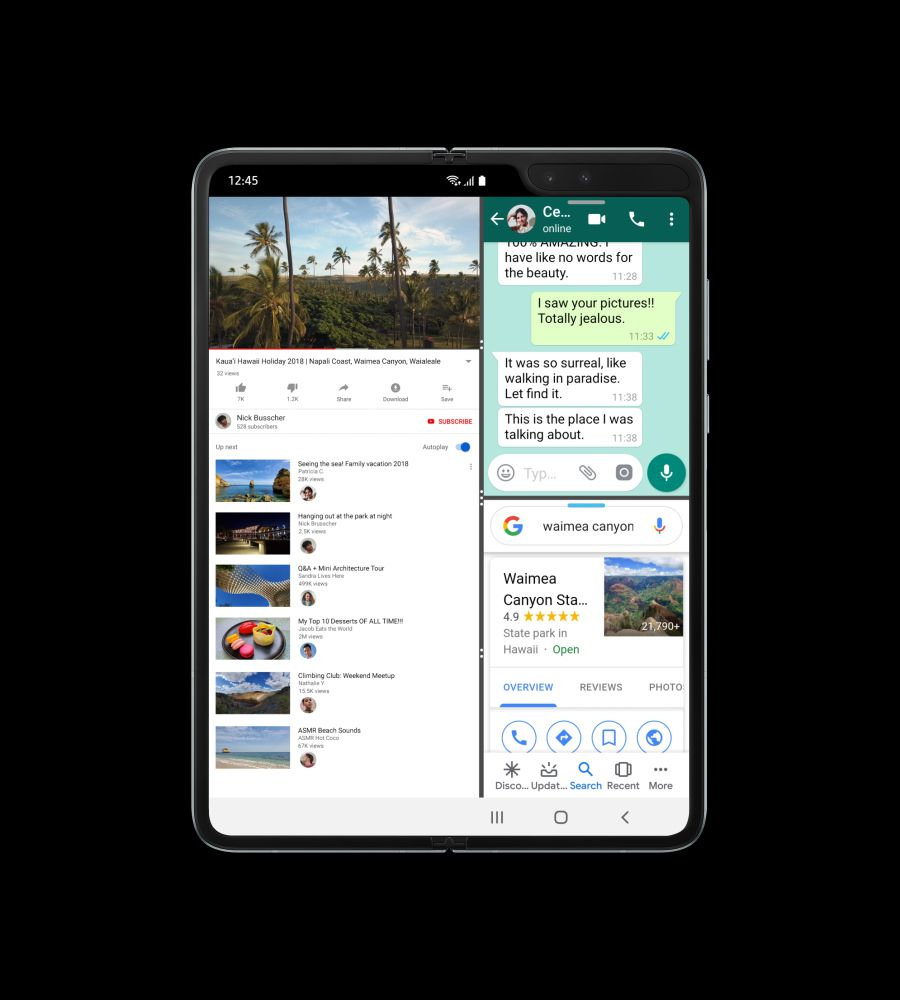 Galaxy Fold, unfolded and seen at a slight angle with a video of a beach on-screen. Then a blue dot swipes left at the edge of the screen to open the WhatsApp app and the screen splits and the video is on one side with WhatsApp on the other. Then it swipes again to open Google, which opens under WhatsApp with the video still open to demonstrate three-app multitasking