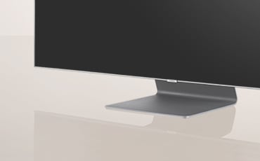 A Close up shot of stand design of the 2019 new Samsung QLED Q90R. Image shows the bending plate design of Q90R stand.