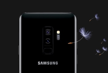Galaxy S9 or S9+ seen from the rear with dandelion seeds floating to the side