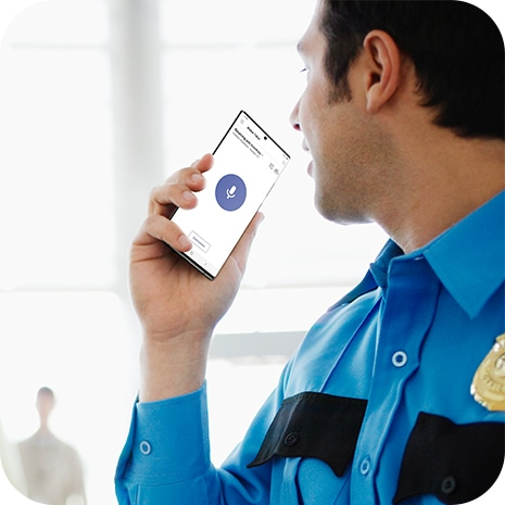 An officer holding Galaxy Note20 Ultra and using the Walkie Talkie function on Microsoft Teams.