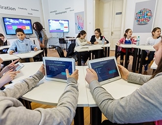 This is a photo of students using tablets in class.