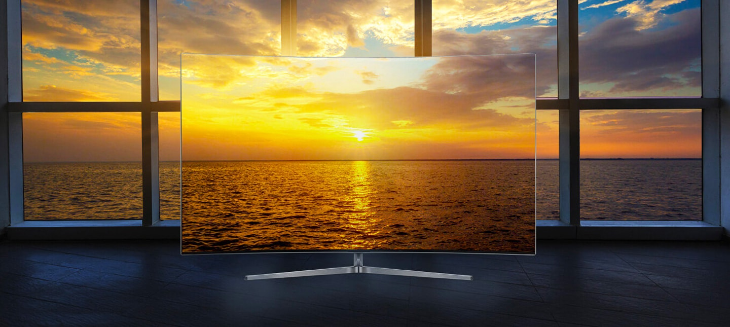 Samsung LEDs a bezel-less slim tv showing a seamlessly connected image of sunset inside a tv and outside