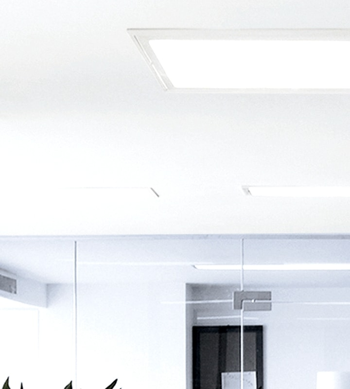 Samsung LEDs spaceous office bright with ceiling light turned on.