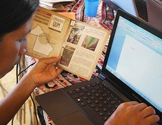 This is a photograph of someone using the computer.