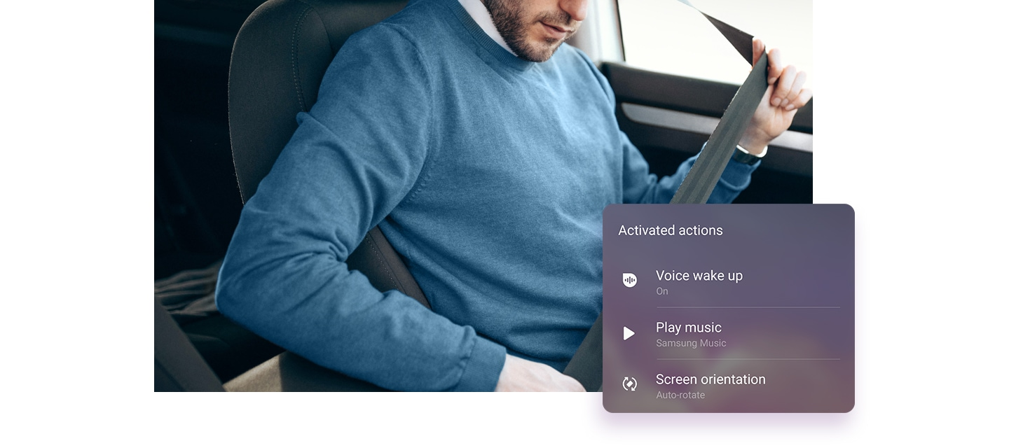 Image of a man in his car buckling his seat belt. On the side is the Activated actions window and it says Voice wake up on, Play Samsung Music, and auto-rotate Screen orientation.