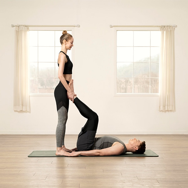 Base and flyer in starting position for yoga pose