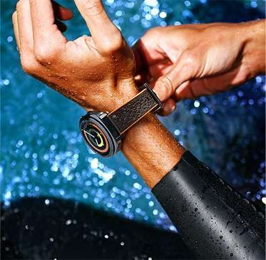 Image of person wearing Gear Sport at the pool with Hybrid Sport strap in orange