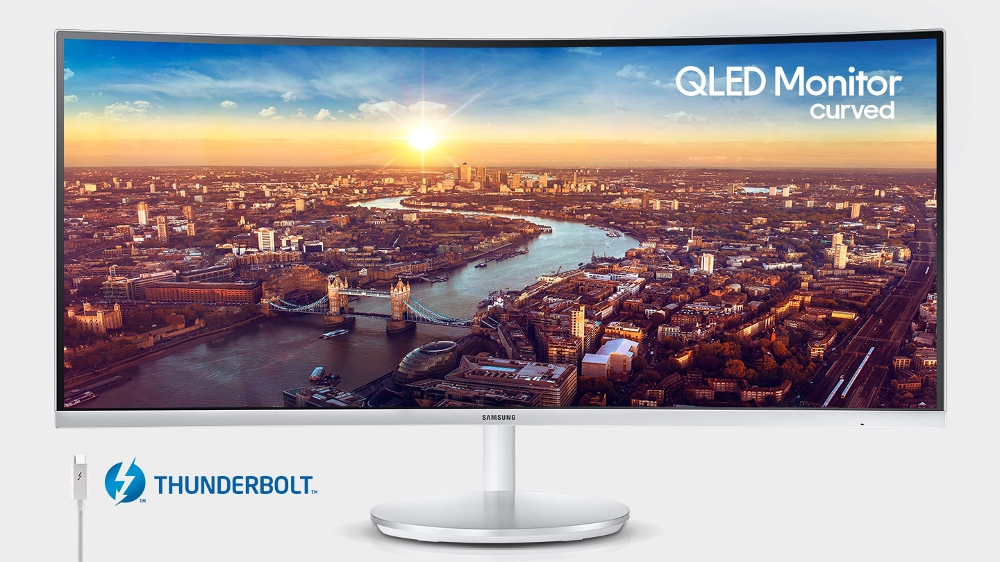 The QLED curved monitor depicts the city seen from a distance, along with one of its features, Thunderbolt.