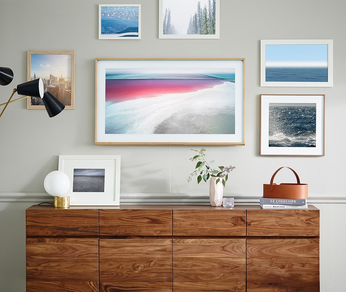 The Frame on the wall displaying artwork among other picture frames.