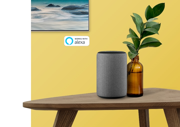 Google Alexa displayed on a white table, connected to a 2019 Samsung Smart TV.