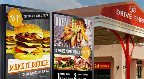 A Samsung outdoor signage displaying menu offerings at the entrance of drive thru