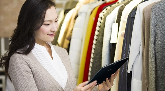 A customer instantly checking further information about clothes using Samsung tablet