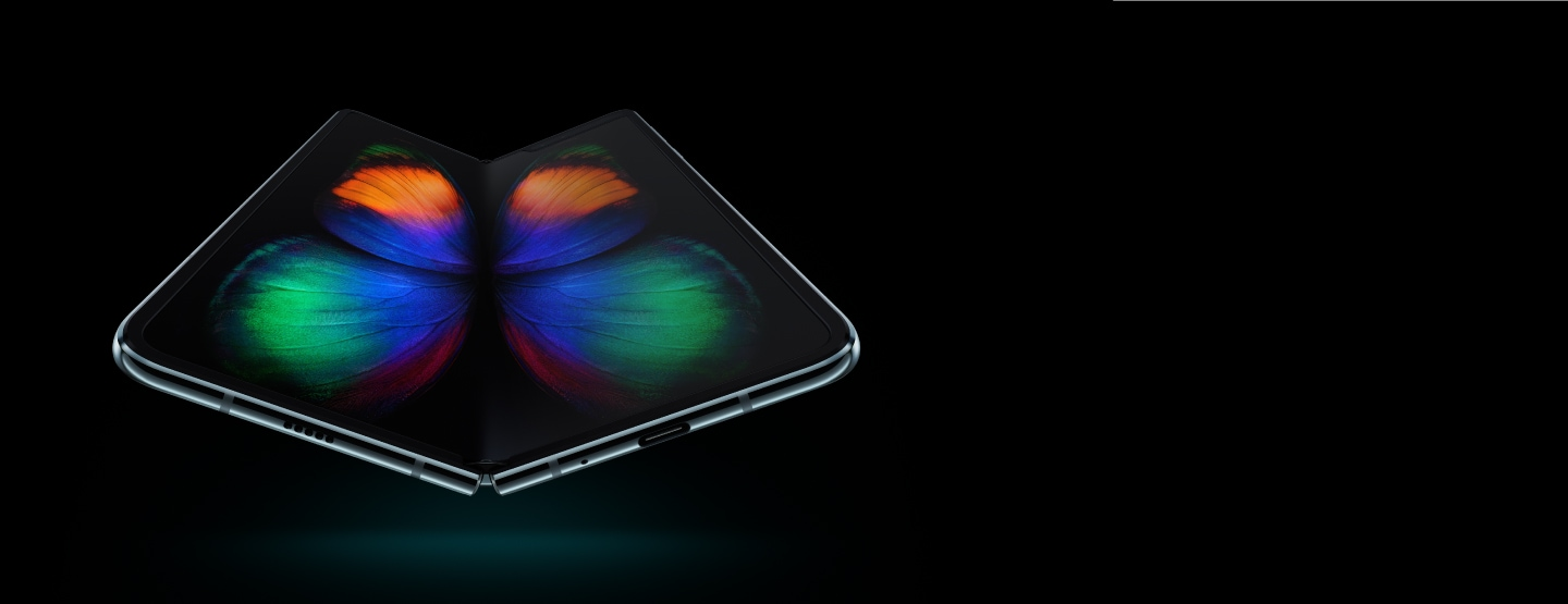 Galaxy Fold in Space Silver seen at a slight angle from the bottom, unfolded, with a multicolor butterfly graphic on-screen