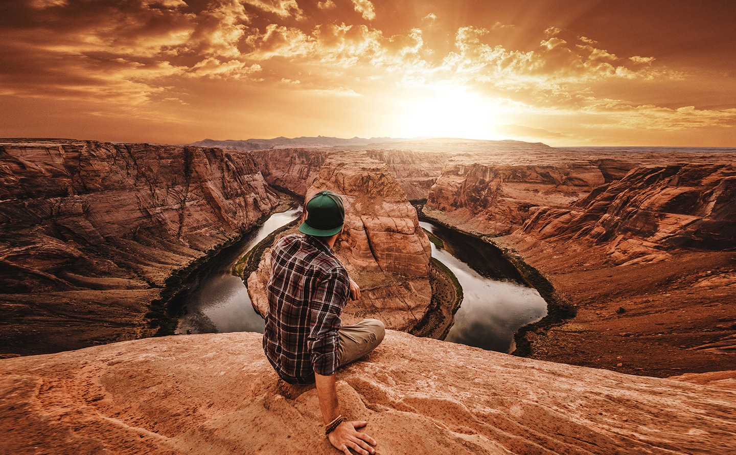 Photo captured by Galaxy A's Ultra Wide camera of a man sitting overlooking a canyon.