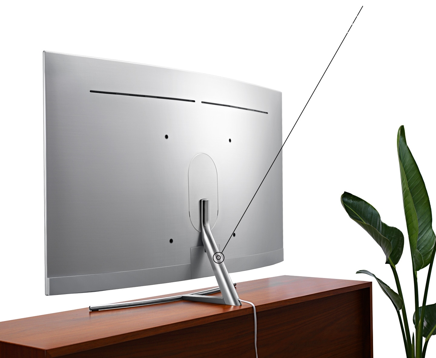 There is QLED TV on the timber shelf with its back and at the tip of the stand, power cable is connected.