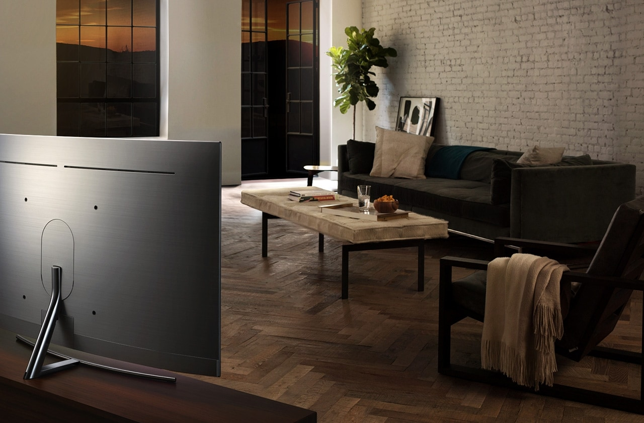 It shows the back of QLED TV in harmony with the hardwood interior.
