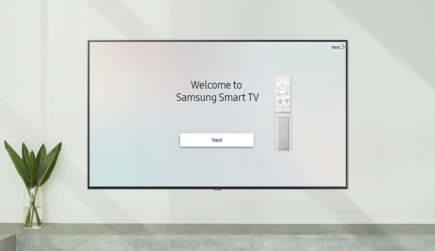 """Smart TV placed on the wall with the welcome screen; """"Welcome to Samsung Smart TV"""" with One Remote Control."
