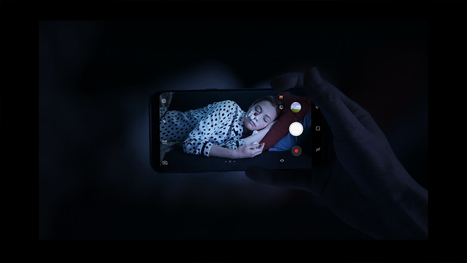 Thumbnail of friend playing a prank on a friend sleeping and taking a photo of it in the dark with the Galaxy S8 or S8+ camera