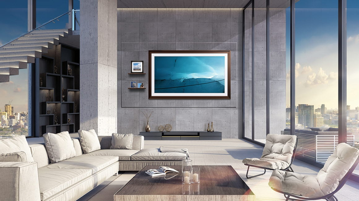 The Wall display in a bright, modern living room with a view of a serene landscape