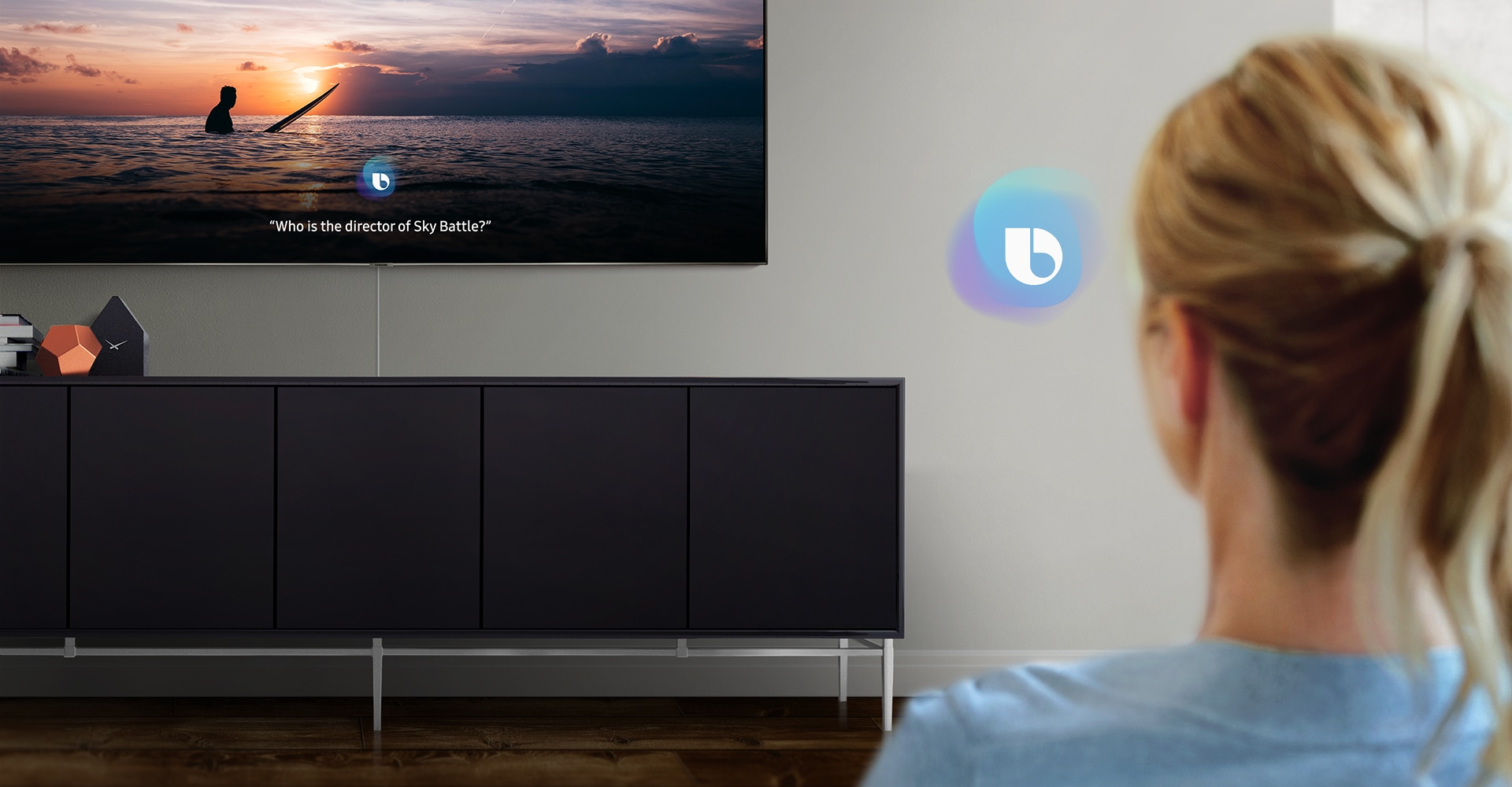 2019 QLED TV displaying a screen in Samsung Bixby mode. A woman is talking with the voice assistant Bixby.