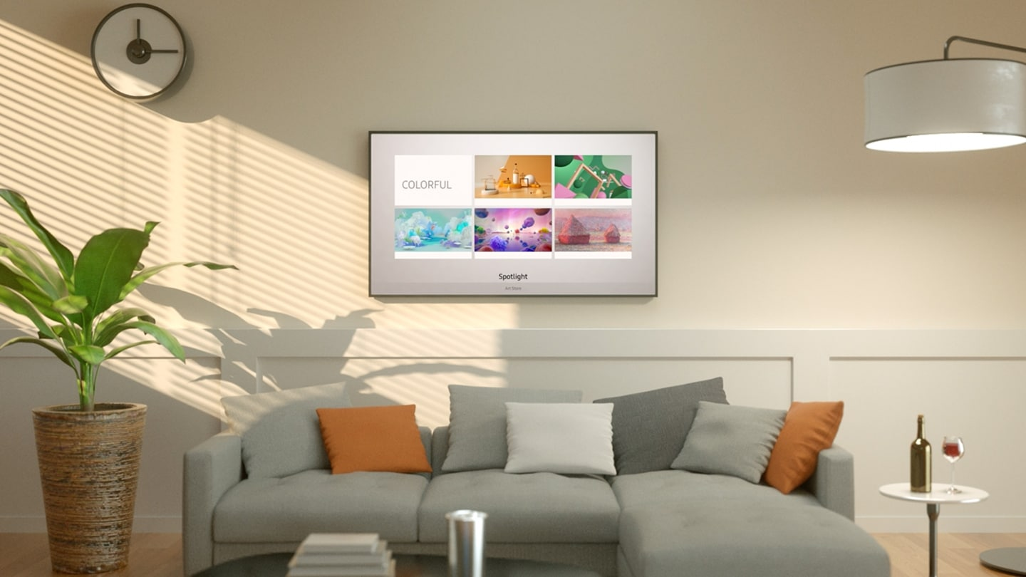 A guy is sitting on a sofa in the living room watching TV. The wall behind The Frame TV opens, followed by numerous Frame TVs displaying various art pieces. The guy walks into one of the art pieces. The screen zooms out and shows the Art Store displaying colorful art pieces. The Frame TV displays various art pictures that fit into different room interior