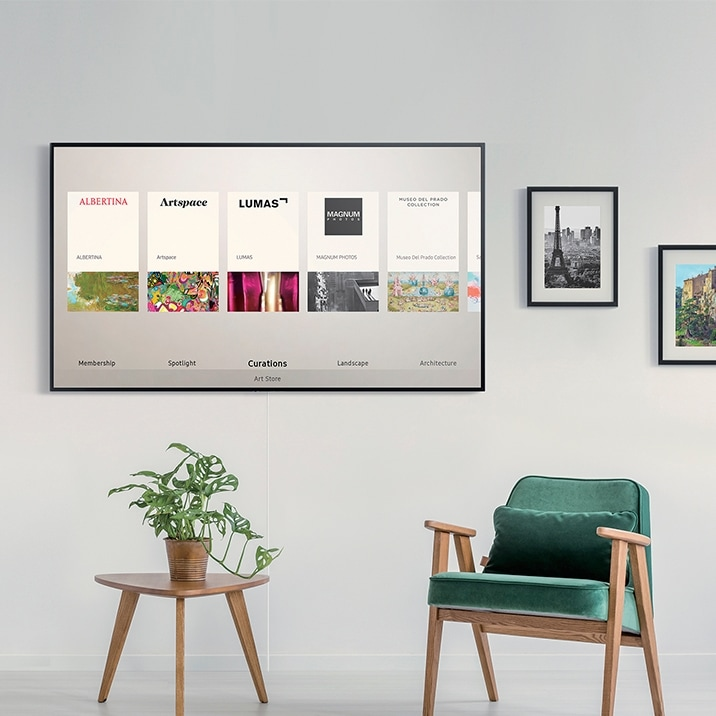 Samsung's The Frame on the wall displaying 'Art Store' User Interface