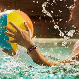 Thumbnail of person playing in a pool wearing Gear Fit2 Pro