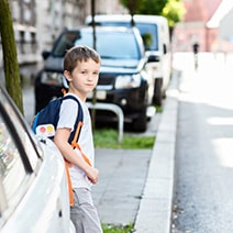 Young boy checking the street before crossing the road