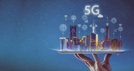 Hand holding up a city connected by 5G