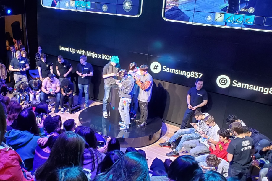 The interior of the Samsung 837 Experience Space, full of gamers, Ninja and members of iKON battling it out in Fortnite