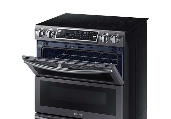 There's a Samsung dual door oven. And the upper door is open.