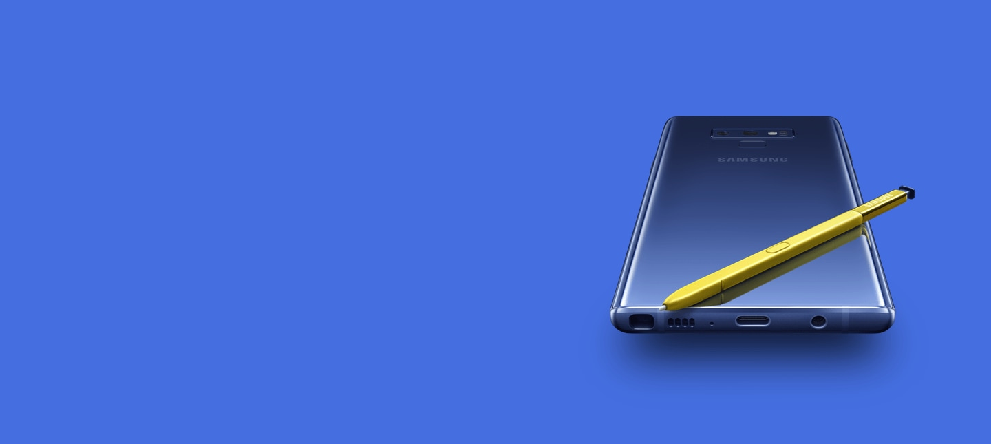 Ocean Blue Galaxy Note9 laying screen-down with yellow S Pen on top, viewed from the bottom
