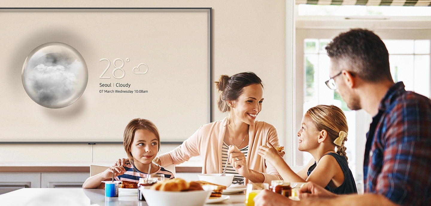 A close-up shot of Samsung QLED TV in a living room with a little girl on the screen. Samsung QLED TV creates complete immersion in your day-to-day life, making every moment matter.