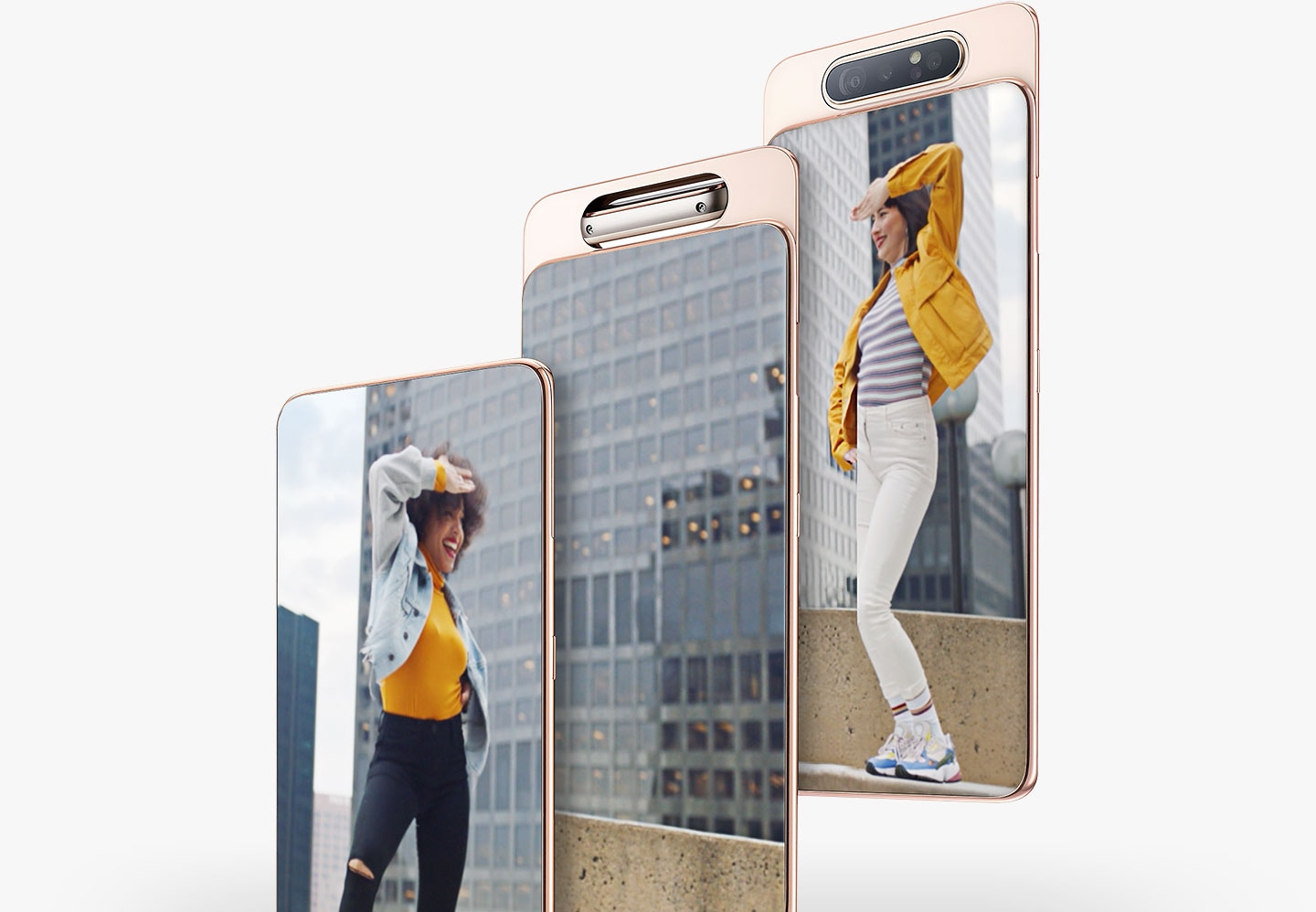 Three photos captured by Galaxy A80's Rotating Camera when it faces the rear to capture a woman dancing, then faces front to capture another woman dancing.