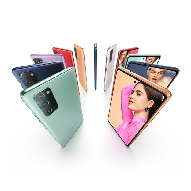 Eleven Galaxy S20 FE 5G phones standing upright in a circle, alternating Cloud Mint, Cloud Navy, Cloud Lavender, Cloud Red and Cloud White. Some are seen from the rear and some are seen from the front, with photos of people onscreen. Each person stands against a color background that matches the color of the phone.