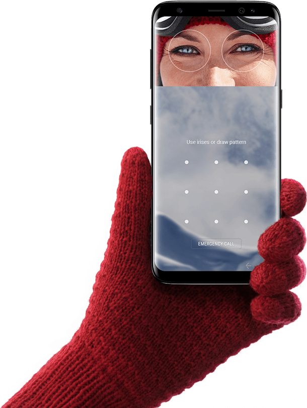 Hand wearing glove holding up Galaxy S8 for iris scanning