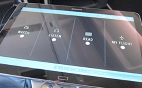 An image showing the front of a tablet that has been installed on an airplane