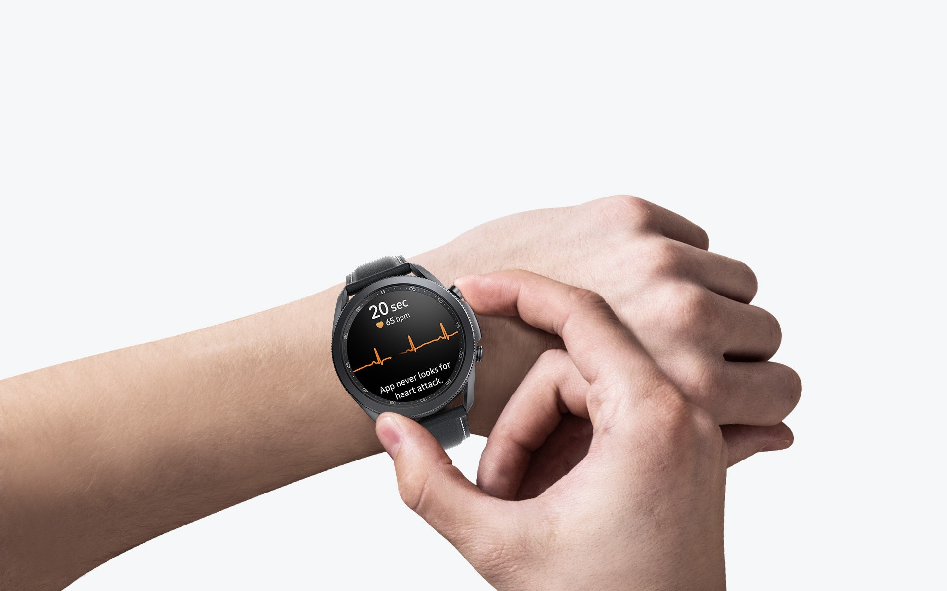 A view of an arm wearing the 45mm Galaxy Watch3 in Mystic Black. A hand presses a button on the side of the watch to measure ECG, with its GUI seen on the watch face.