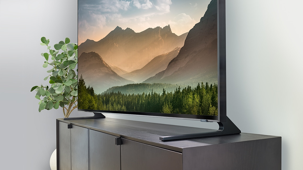 A Close up shot of stand design of the 2019 new Samsung QLED Q900R. Image shows the wide-sieded stand design.