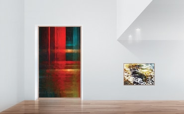 A vertically long The Wall display mounted into the wall of a simple, white gallery and showing a vertically long, modern painting.
