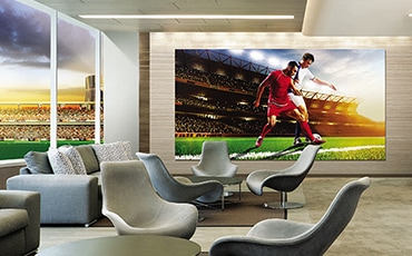 The Wall display in a luxury VIP suite of a soccer stadium utilized to show a live stream of the sporting event.