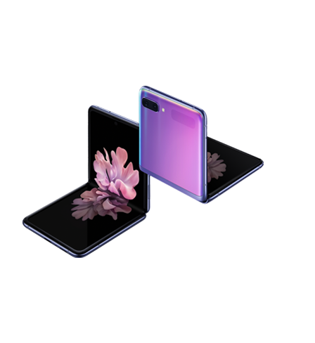 Two Galaxy Z Flip phones in Mirror Purple at a three-quarter angle, one seen from the front and one seen from the rear. Both are folded at right angles with freestop folding. The one seen from the front has the blossoming flower wallpaper onscreen