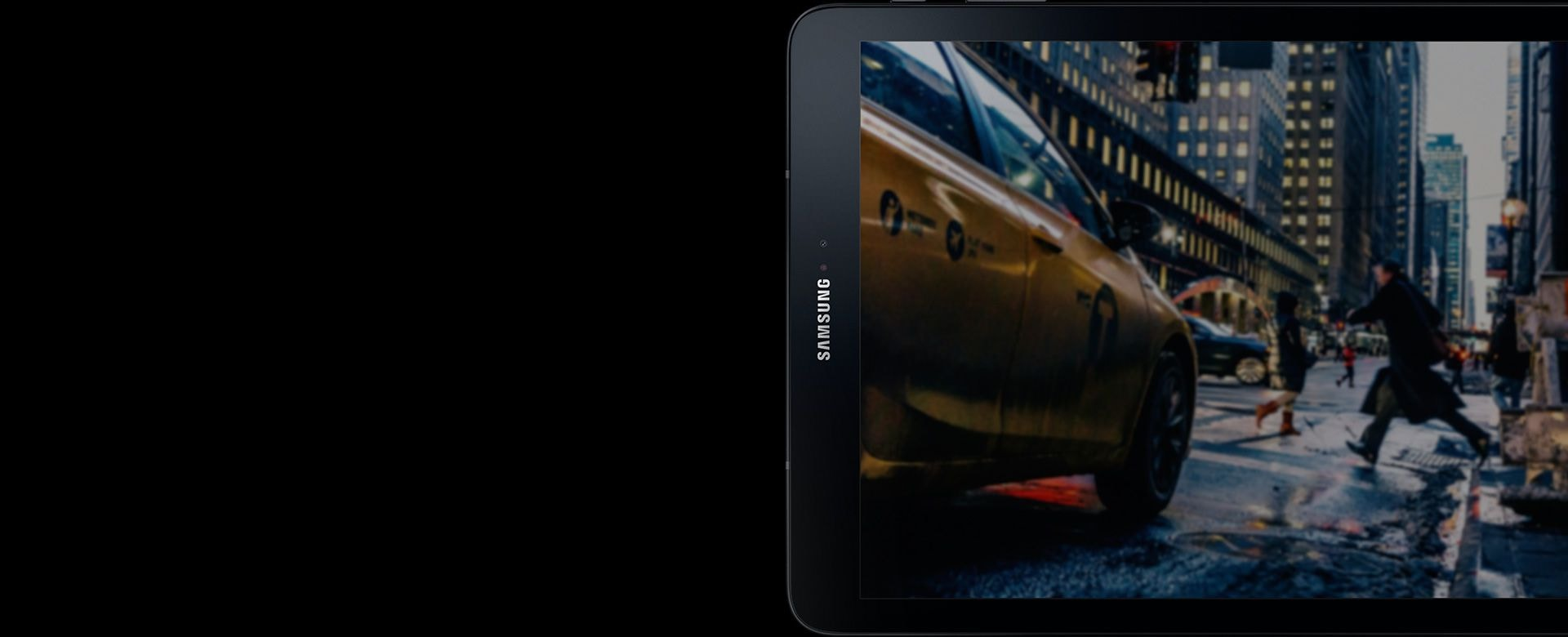 Galaxy Tab S3 standing sideways with image of a yellow cab downtown