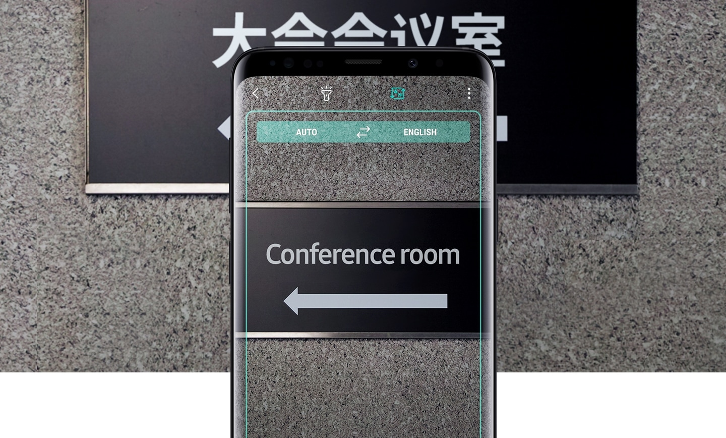 Galaxy S9 or S9+ displaying Live Translation GUI with translated sign onscreen and untranslated sign in the background